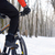Mountain Biker Riding Bike on the Snowy Trail in Beautiful Winter Forest. Free Space for Text. stock photo © maxpro