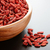 wooden bowl full of dried goji berries on the dark table stock photo © maxpro