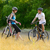 young happy couple riding mountain bikes outdoor stock photo © maxpro