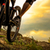 professional cyclist riding the bike down rocky hill at sunset extreme sport space for text stock photo © maxpro