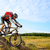 cyclist riding the bike down rocky hill stock photo © maxpro