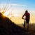 silhouette of enduro cyclist with mountain bike on the rocky trail at sunset active lifestyle conce stock photo © maxpro