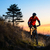 enduro cyclist riding the mountain bike on the rocky trail at sunset active lifestyle concept spac stock photo © maxpro