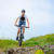 cyclist riding the bike on beautiful spring mountain trail stock photo © maxpro