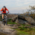 Cyclist in Red Jacket Riding the Bike on Rocky Trail. Extreme Sport. stock photo © maxpro