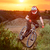 professional cyclist riding the bike on the mountain rocky trail at sunset extreme sport stock photo © maxpro