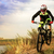 professional cyclist riding the bike at the rocky trail extreme sport concept space for text stock photo © maxpro