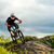 professional cyclist riding the bike on the rocky trail extreme sport stock photo © maxpro