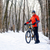 Mountain Biker with Bike on the Snowy Trail in Beautiful Winter Forest stock photo © maxpro