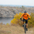 cyclist riding bike on the beautiful autumn mountain trail under river stock photo © maxpro