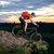 cyclist riding the bike down hill on the mountain rocky trail at sunset stock photo © maxpro