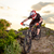 professional cyclist riding the bike down rocky hill at sunset extreme sport stock photo © maxpro