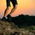 close up of sportsmans legs running on the rocky mountain trail at night active lifestyle stock photo © maxpro