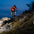 enduro cyclist riding the bike on the rock at night extreme sport concept space for text stock photo © maxpro