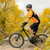 Cyclist Riding Bike on the Beautiful Autumn Mountain Trail stock photo © maxpro