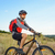 cyclist riding the bike on the beautiful summer mountain trail sport concept stock photo © maxpro