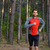 Young Man Running on the Trail in the Wild Pine Forest. Active Lifestyle stock photo © maxpro