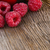 fresh ripe sweet raspberry on wooden background stock photo © maxpro