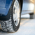 close up image of winter car tire on the snowy road drive safe stock photo © maxpro
