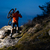 enduro cyclist taking his bike up the rocky trail at night extreme sport concept space for text stock photo © maxpro