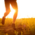 close up of sportsmans legs running on the rocky mountain trail at sunset active lifestyle stock photo © maxpro