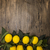 Branch of fresh juicy Sicilian lemons on a wooden background stock photo © mcherevan