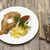 petite wiener schnitzel with boiled potatoes and ketchup served on a white porcelain plate with for stock photo © mcherevan