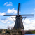 traditional dutch windmill near the canal netherlands old windmill stands on the banks of the cana stock photo © mcherevan