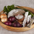 Onions, brown bread wooden tray with parsley and salt, salami celery ,knife stock photo © mcherevan