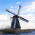 old traditional windmill in the dutch canals netherlandswhite clouds on a blue sky the wind is b stock photo © mcherevan