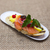 fresh spanish tapas on bread baguette smoked norwegian salmon with black olive butter herbs and oni stock photo © mcherevan