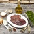 pieces of fresh raw beef liver onion garlic spices dill parsley salt knife olive oil on porc stock photo © mcherevan