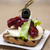 delicious spanish tapas with a rustic mozzarella and dried tomato with olive stock photo © mcherevan