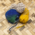 three ball of woolen threads yellow blue beige and steel knitting needles stock photo © mcherevan