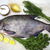 a large live bream river fish fish lying on a paper background with and slices of lemon and with stock photo © mcherevan