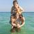 fiútestvérek · élvezi · meleg · víz · játék · háton - stock fotó © meinzahn