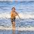 lopen · strand · glimlachend · kind · zee - stockfoto © meinzahn