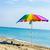 guarda-sol · colorido · areia · praia · céu · sol - foto stock © meinzahn