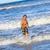 młody · chłopak · uruchomiony · plaży · uśmiechnięty · dziecko · morza - zdjęcia stock © meinzahn