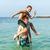 fiútestvérek · játszik · háton · óceán · együtt · ugrik - stock fotó © meinzahn
