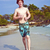 young boy with red hair in swimsuit is running along the beautif stock photo © meinzahn