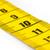 yellow measuring tape isolated   selective focus stock photo © michaklootwijk