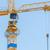 yellow crane and blue sky stock photo © michaklootwijk