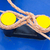 twisted orange rope round a yellow bollard stock photo © michaklootwijk