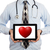 doctor holding tablet   red heart stock photo © michaklootwijk