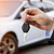 male holding car keys with car on background stock photo © mikdam