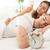 спальный · пару · кровать · молодые · гетеросексуальные · пары · будильник - Сток-фото © MilanMarkovic78