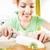 young woman slicing kiwi stock photo © milanmarkovic78