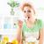 mulher · jovem · comer · salada · de · frutas · belo · cozinha · olhando - foto stock © MilanMarkovic78