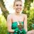 beautiful woman planting flowers stock photo © milanmarkovic78